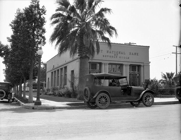 """I had a bit of a chuckle when I saw this 1921 photo of the First National Bank of Beverly Hills—it made me wonder, """"Was there a second one?"""" Mind you, with all the money that floats around Beverly Hills, there might have been! After a bit of sleuthing, I found that this bank stood at 1418 Burton Way, which puts it on the curve near where Burton Way meets LA Cienega. I also discovered they printed their own bank notes and I have one posted on my website: http://wp.me/p5XK3w-2nP"""