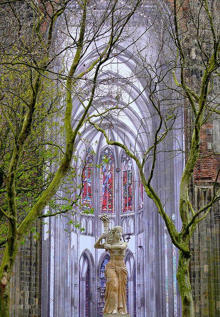 Statue in front of the Domkerk in Utrecht, Netherlands .