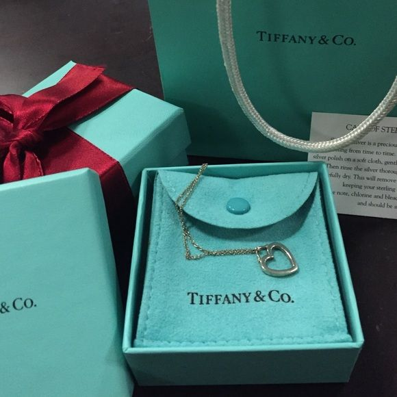 Authentic Tiffany heart necklace and chain Gorgeous Tiffany heart necklace comes with satchel and box. GUC. Pendant and chain included Tiffany & Co. Jewelry Necklaces