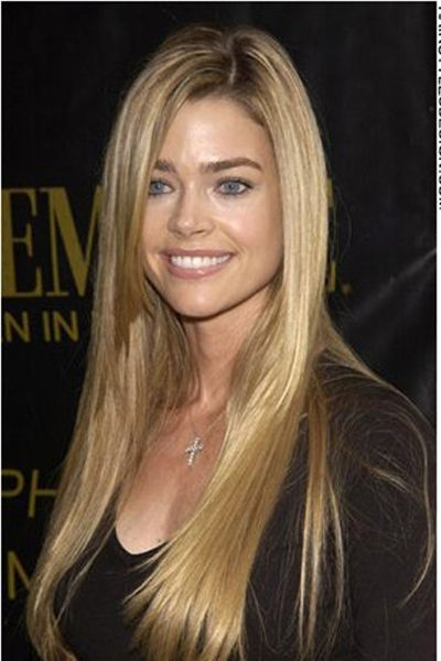 This length hair is absolutely incredible. Denise Richards hair is straight with very long bangs that come down at one side of the face. This celebrity looks great with this conservative style.Denise's haircut is very long.This blonde hair colouring simply shines.