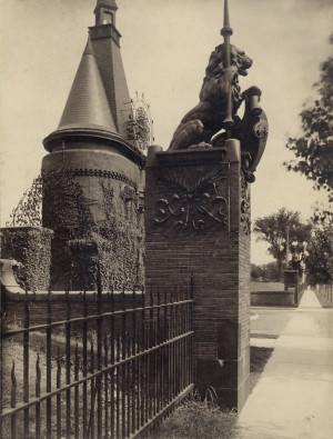 Lion on Washington Terrace gate at Union Boulevard intersection, with entrance turret behind it. (1900) ©Missouri History Museum