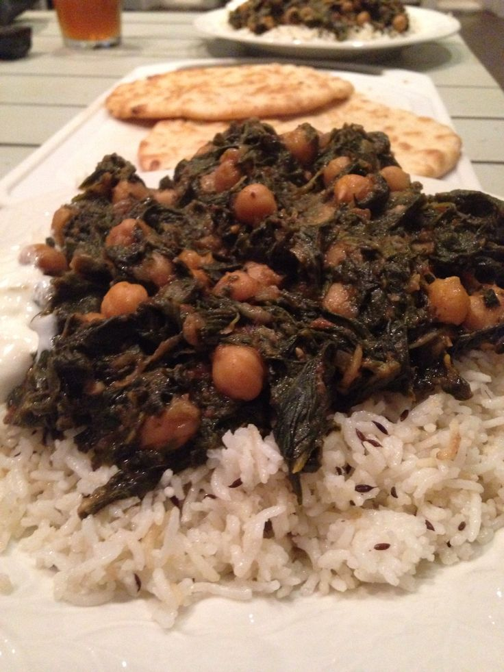 Chana saag served with rice, yogurt, and naan. Saag made with spinach, Swiss chard, and flat leaf kale
