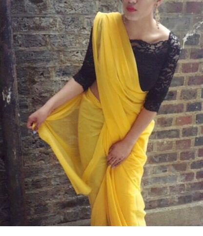 Not overdressed or even underdressed! Yellow plain saree with a black lace blouse/crop top