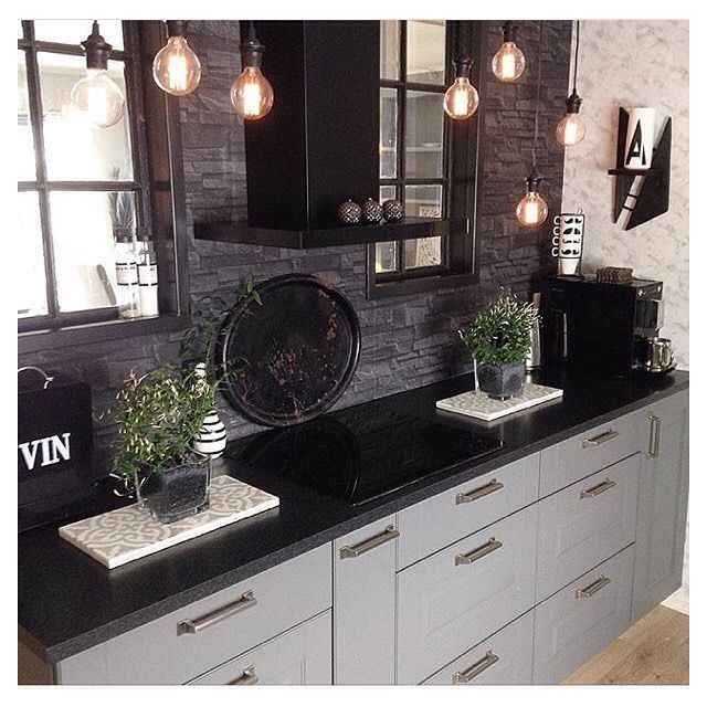 Kvik's Ponte kitchen transports you back to a romantic country idyll Smooth steel handles help to complete the look of the grey doors and related dark worktop. Cred: @molohei #pontebykvik #kvikkitchen #kvik #kitchen