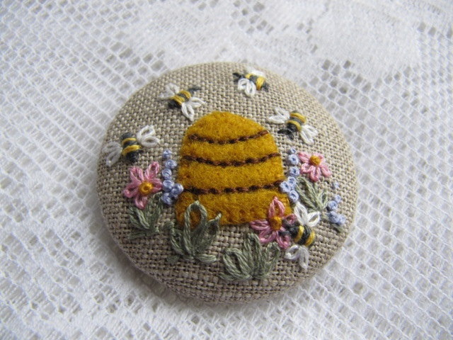 "Brooch  2""- Emboidered Bee Hive on linen. $18.00, via Etsy."