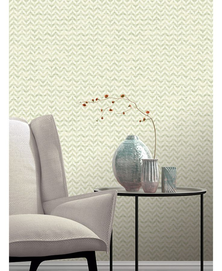 This Incanto Leaf Geometric Wallpaper in green and white features a geometric leaf pattern with contrasting finishes and glitter and metallic elements. Free UK delivery available