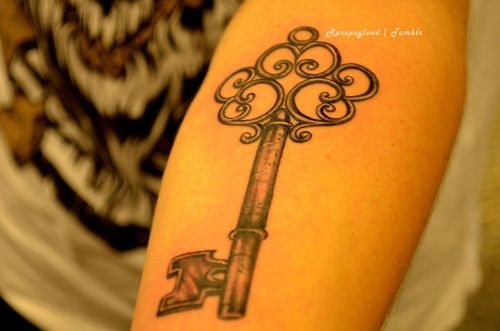 "Antique key tattoo idea, ""unlock your dreams"" on the inner bicep"