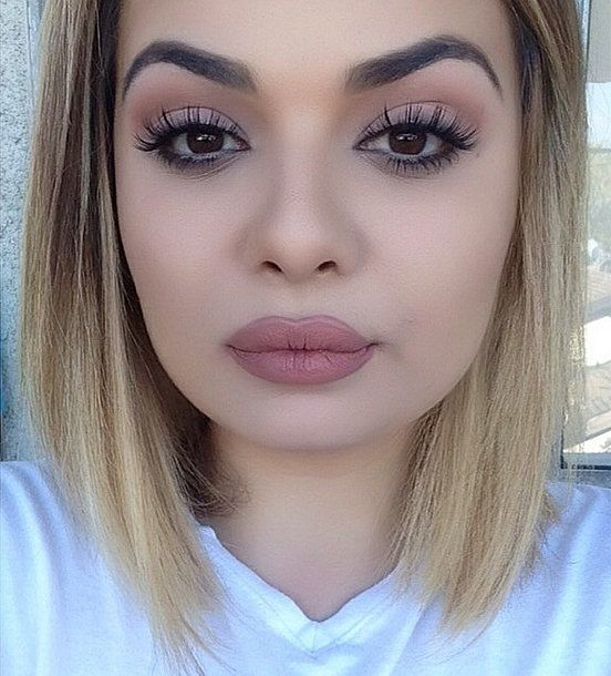 Long lashes, matte skin, and an overdrawn upper lip are beauty staples of Kylie Jenner's selfies. This fan took the look to the next level.