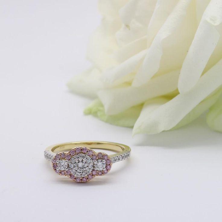 Argyle pink diamond halo yellow gold ring. Diamond luxury at its finest.