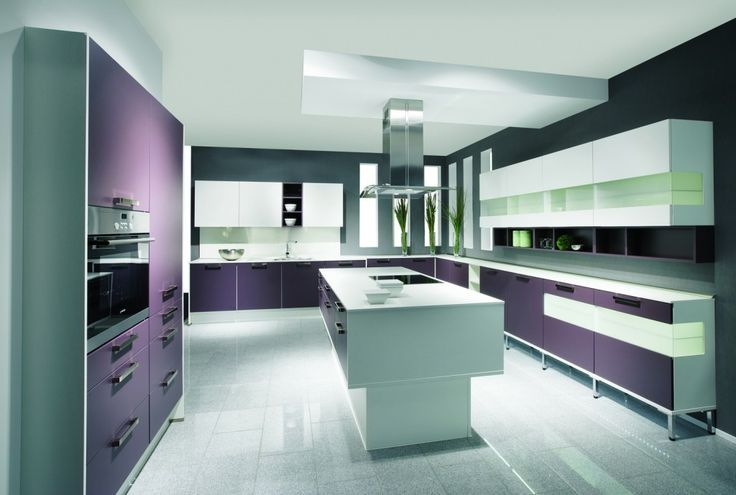 With a central island and beautifully integrated appliances, this particular kitchen used a combination of bright, vivid purples and monochrome tones to create a contemporary and elegant room.
