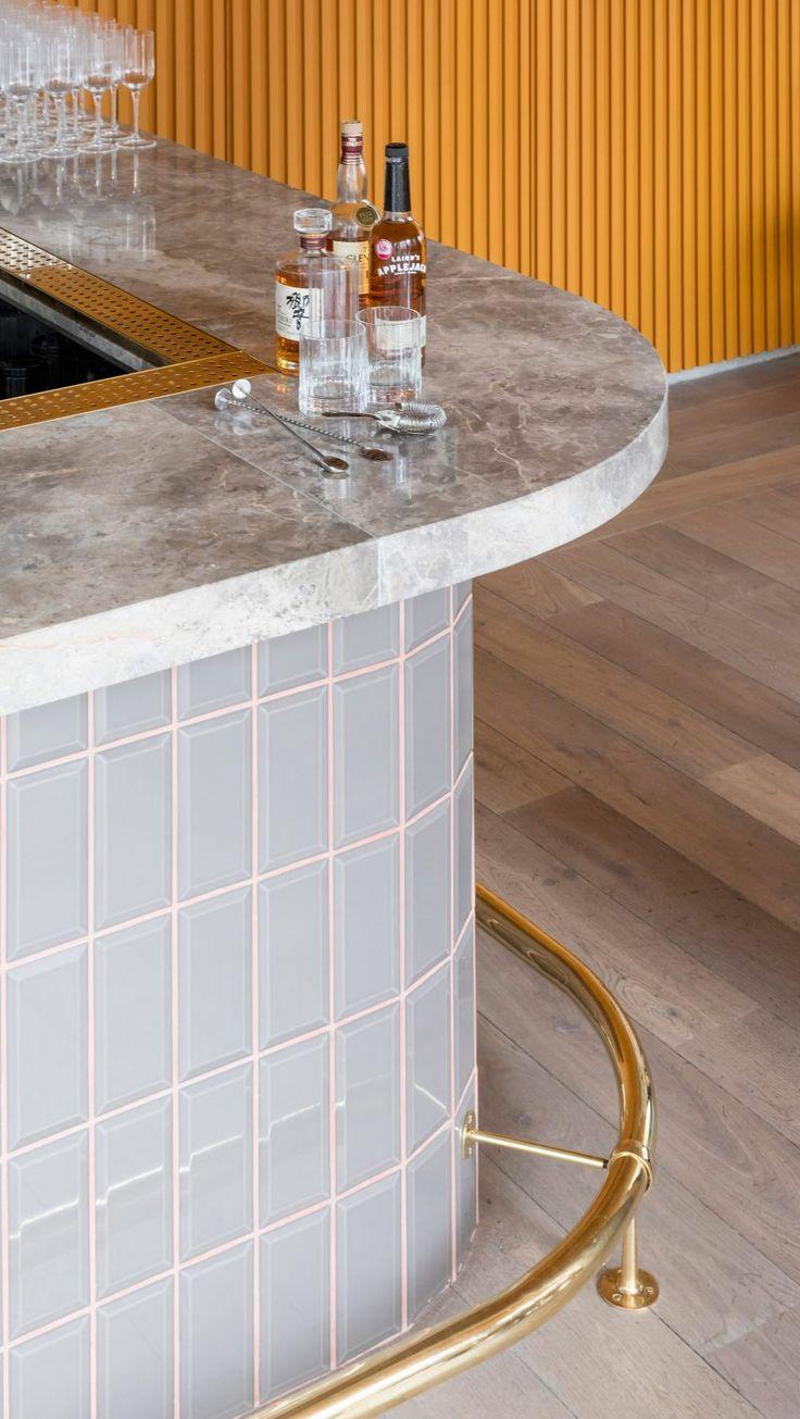 Cement greys meet bright ochre in Grzywinski + Pons' London restaurant interior