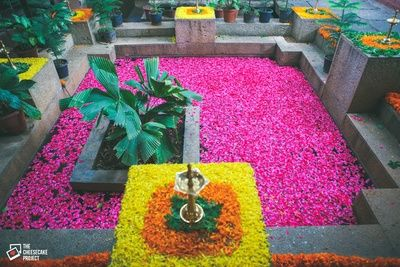 rustic decor, south indian decor, bright pink and yellow, flower petals in water