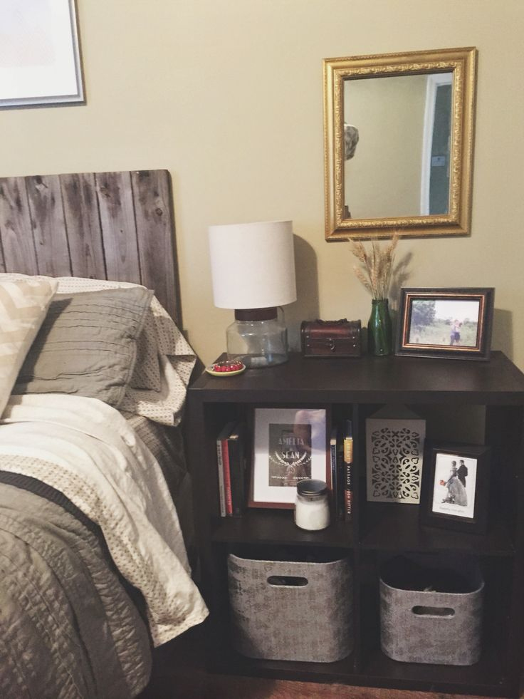 Cubes as a nightstand for extra storage. Spray painted Dollar Tree mirror…