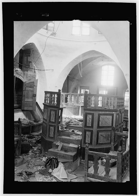 Palestine events. The 1929 riots, August 23 to 31. Synagogue desecrated by Arab rioters. Hebron. Furniture broken, floor littered with torn sacred books