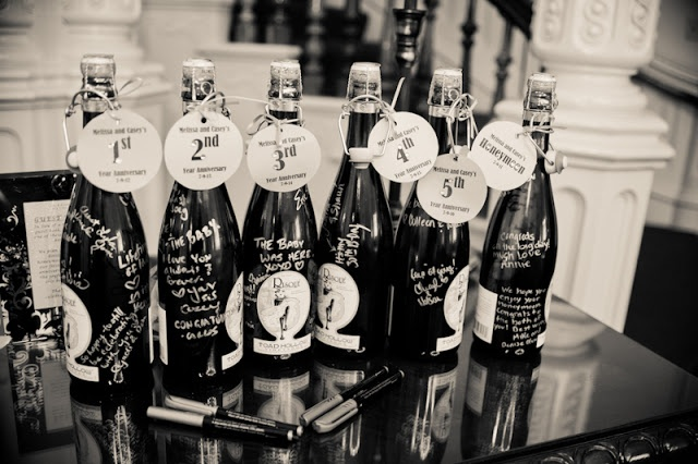 The couple used champagne bottles as a guest book. Each bottle will be opened and enjoyed on future anniversaries. :)    Do it for 5th, 10th, 15th and 20 th anniversary