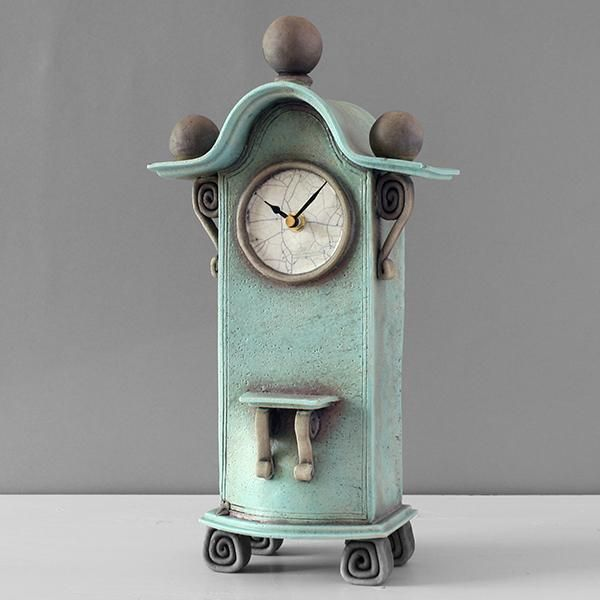 quirky ceramic mantel clock - tall - duck egg blue by ian roberts TBLBS - This wonderful very tall duck egg blue ceramic mantel piece clock has been handmade by Ian Roberts. The clock is raku fired and hand painted, giving it a unique finish, in this instance a shimmering l
