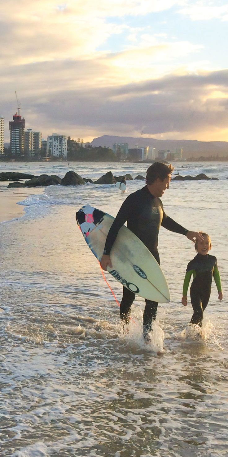 Father-son surfing on the Gold Coast - by Paul Fleming