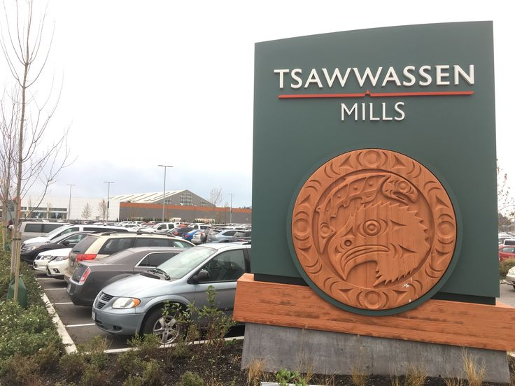 Entrance sign with Aboriginal art  For more information, including store list, and additional photos of Tsawwassen Mills, go to: http://urbanyvr.com/tsawwassen-mills-store-list-photos