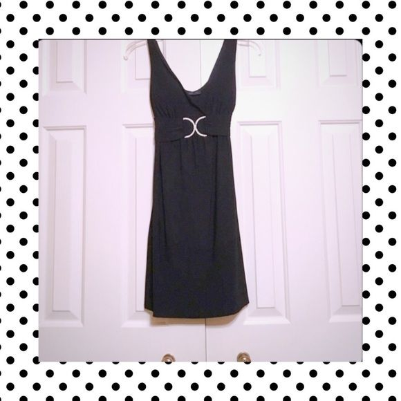 REDUCED: Cute & Petite Black Dress This little black dress is in great condition & ties in the back to show off those curves                           ❤️ Smoke Free Home  ❤️ No Trading  ❤️ Offers Considered  ❤️ 10% Off When Bundled  ❤️ Be Blessed! Dresses Mini