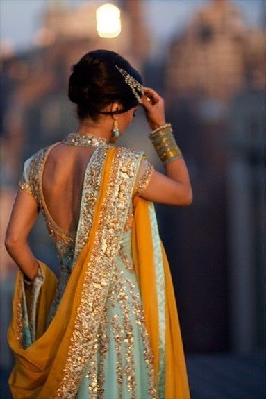 egg yolk-yellow, powder-blue with silver embroidery- traditional indian dress......gorgeous!