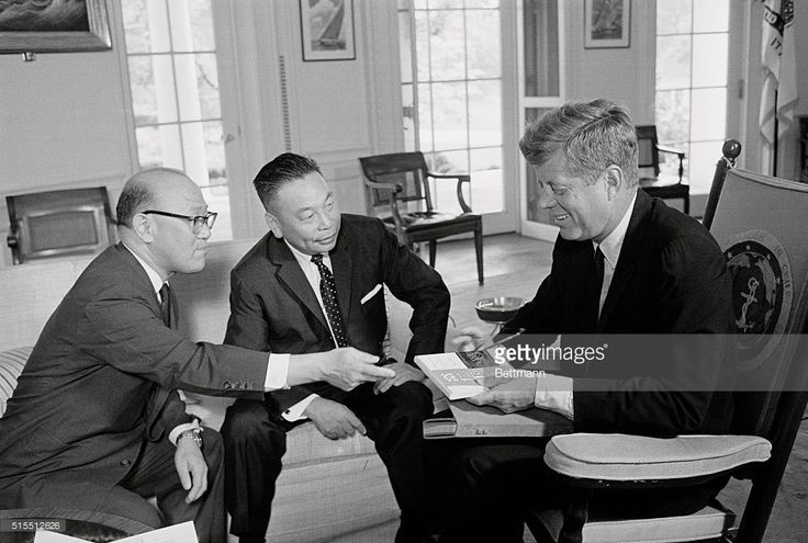 Gen. Chiang Ching Kuo (center) son of Chinese President Chiang Kai Shek is shown during a 75-minute meeting with President Kennedy at the White House. Left is James C.H. Chen, Dir. Chinese Information office. President Kennedy is is holding two books presented to him by the General-Chinese interpretations of his Inaugural Address and his book, Profiles in Courage.
