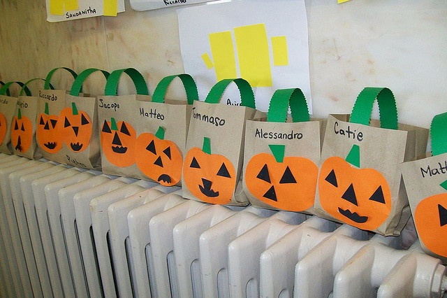 This is a cute activity for a halloween party. The children would paint a pumpkin on a paper bag. The eyes,mouth and nose can be cut out. Staple a green handle made out of green construction paper. Kids will write their names and it can be used for going trick or treating. This is for ages kindergarten and older