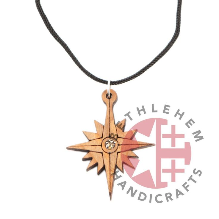 Olive Wood Star of Bethlehem Pendant - This beautiful flower shines with Gods might brightly in Bethlehem. Carved from olive wood it brings you a piece of that light to wherever you may be, so it can grace any loved one in your life, for Gods light is ever present. (#wood #carved crosses, wooden cross, wooden cross necklace, wooden cross, carved wooden crosses, Jerusalem cross, decorative crosses, hand carved wooden crosses, olive tree wood products, wood crafts, olive wood Jerusalem)