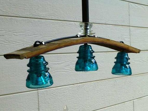 upcycled glass insulators into light fixture