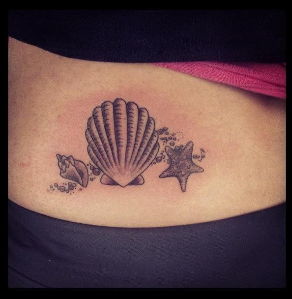 10 beautiful beach seashell tattoo designs for Seashell tattoo meaning