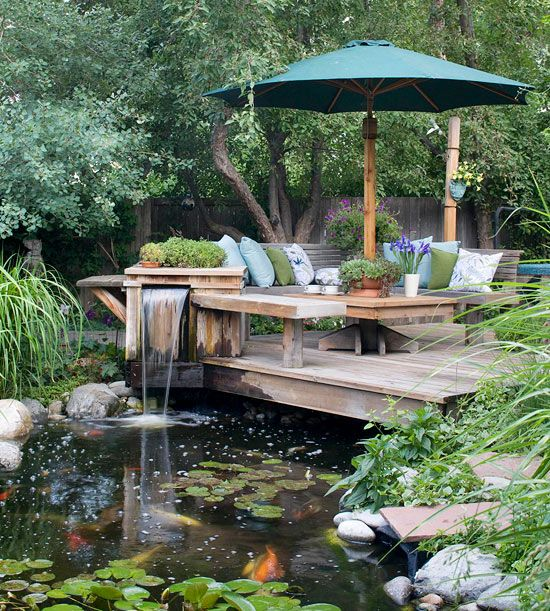 Mature trees make this detached deck feel nestled in the landscape, and a water feature off the end creates a moat effect. These elements combine perfectly to make the deck seem like its in the middle of nowhere -- even though its just feet from the house.