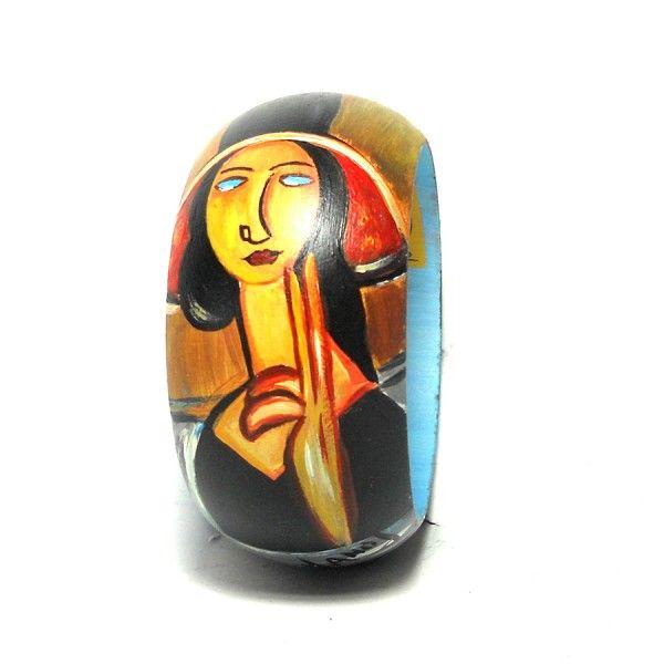 Br89 Bracciale in legno dipinto a mano Ritratto di Modigliani  30.00€  Bracciale in legno dipinto a mano, RITRATTO, MODIGLIANI, su bangle in legno dipinto a mano con diametro interno di 6,5 cm e altezza di 4,5 cm. I colori della creazione possono essere leggermente diverse da come appaiono in foto.
