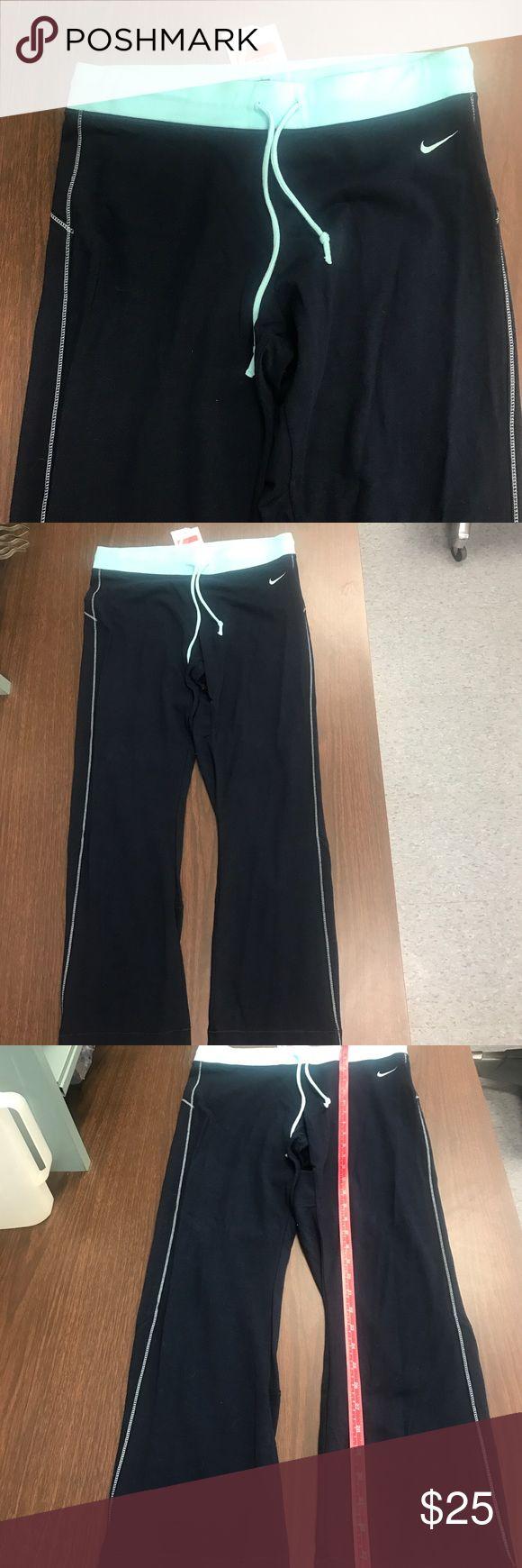 🆕Nike Low rise Training capris 🆕Nike Low rise Training capris. Navy blue with turquoise drawstring/elastic waistband. Size large Nike Pants Capris