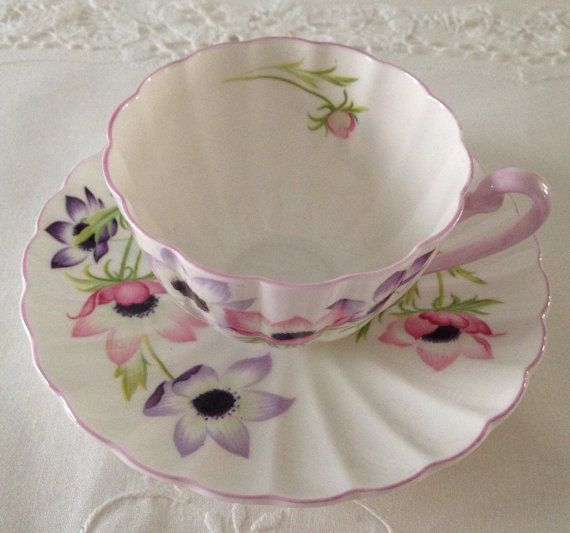 Wonderful vintage Shelley bone china tea cup and saucer, made in England.  Very delicate wind flowers decorate this cup and saucer. It is in