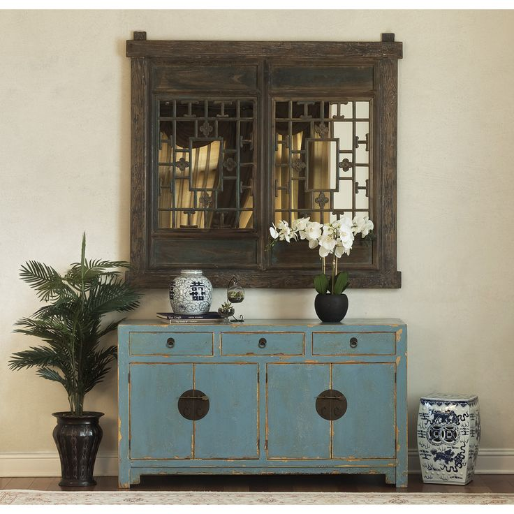 Traditional Chinese Ming Style Sideboard Cabinet, Light Blue Distressed Finish. Unique and refreshing, this Tang sideboard's distressed matte blue finish and its simple, sleek shape liven up any space. Hand-forged brass hardware on its drawers and doors perfectly complement the cabinet's distinctive feel. Oriental style sideboard.