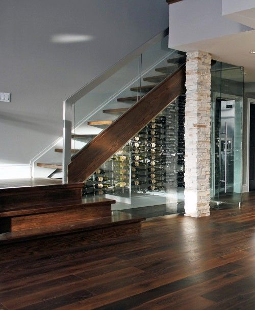How creative...a wine cellar under the stairs! There would be a nice comfortable chair inside and I would be in heaven!