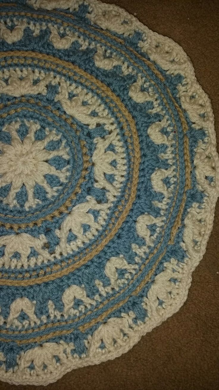 Part 2 of Atlanticus Blanket made by Caroline Stefanie With Caron One Pound in Azure, Off White and Lace. Pattern design by Vanessa Smith Fishcake.