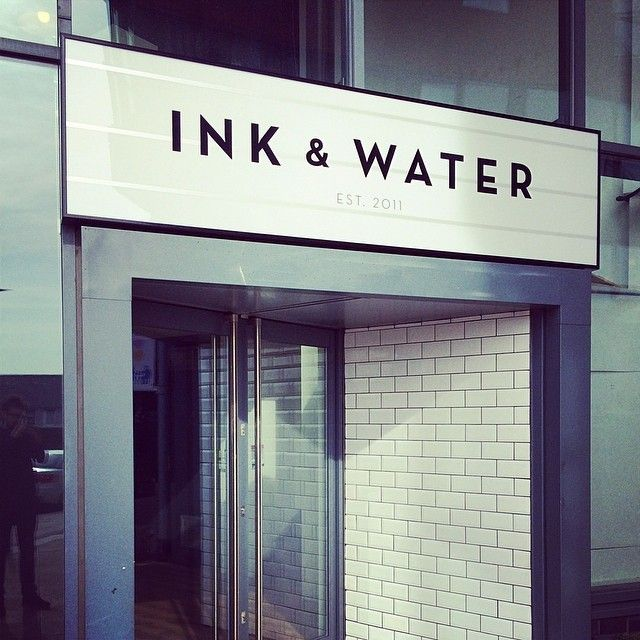 Exterior illuminated sign case for Ink & Water, Sheffield UK, Manufactured and installed by MarqueMakers. #lighbox #black&white