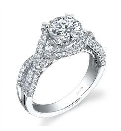 This unique 18K white gold diamond engagement ring features a 1.00 carat round brilliant center diamond. Beautifully designed to accentuate the center diamond, this diamond engagement ring has a total of 0.68 carats of round diamonds flowing down this uniquely designed shank setting. The diamond wedding or engagement ring is available in any size or shape center, in 18K white gold or platinum. All Sylvie Collection diamond engagement rings are available with a flush fit matching wedding…