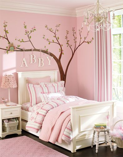 "Sweet Girl's Pink Bedroom...love the cherry tree decal on the wall, with the child's name ""hung"" on a branch to personalize the room.  You could also paint the tree on the wall."