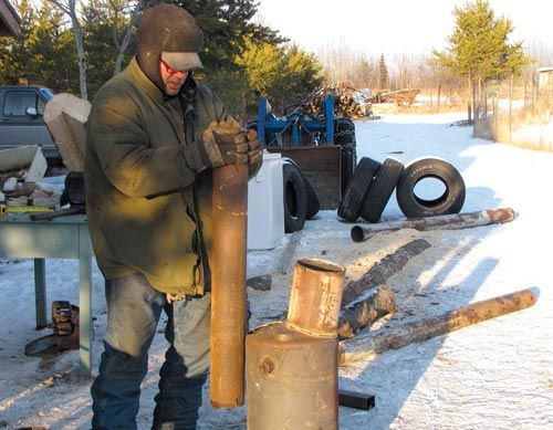 Build a wood-fired stock tank heater | Backwoods Home Magazine