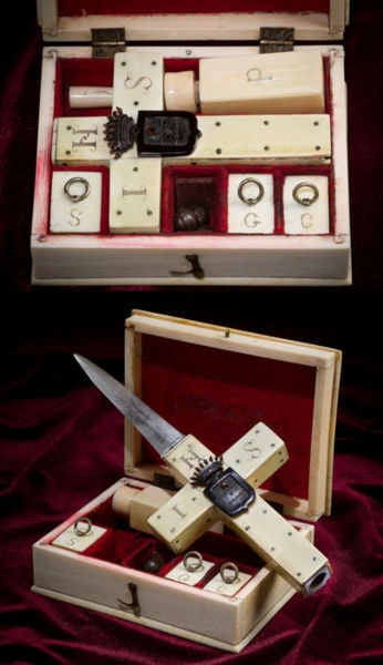 1850s vampire killing kit in ivory case. Ivory clad percussion pistol with removable dagger. Kit includes caps, balls, ivory powder bottle, and ram rod.