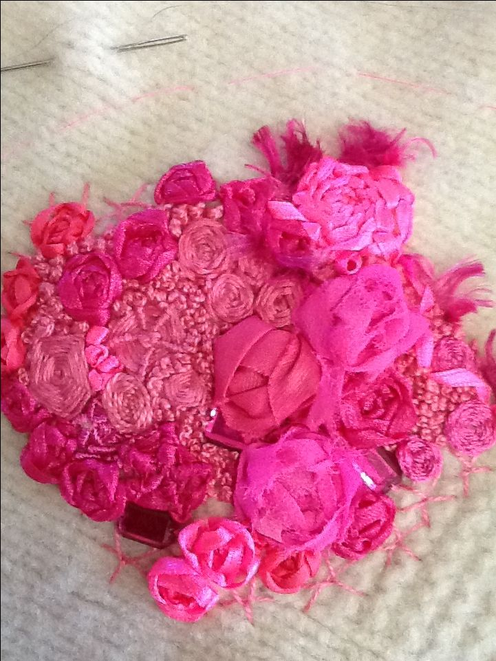 Susan Barker Over Stone - hot pink, spider web roses And beading.