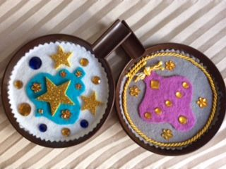 The last two Christmas ornaments on recycled plastic saucers