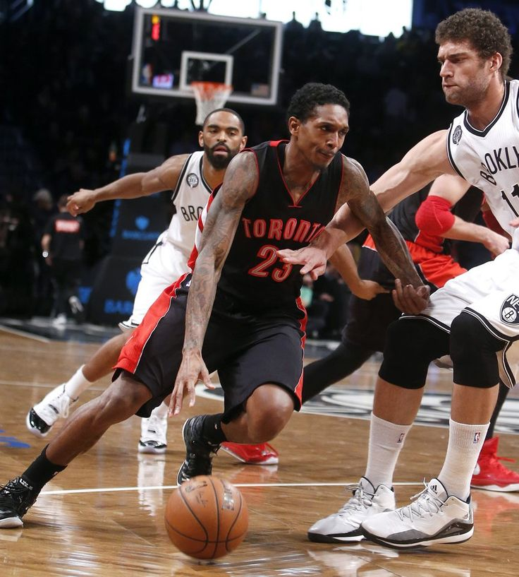 Toronto Raptors' Lou Williams (23) drives against Brooklyn Nets' Brook Lopez during the second quarter of an NBA basketball game Friday, Jan. 30, 2015, in New York. (AP Photo/Jason DeCrow)