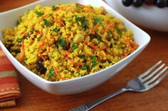 Healthy Curried Couscous salad with carrots, raisins, apples, green onion cilantro, sliced almonds
