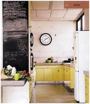 Concrete countertops on metal cabinets. Nice industrial look without being too heavy thanks to the natural light & bright color. The chalk board wall is also a nice interior design 2012 room design home design design house design Modern Kitchen Design, Interior Design Kitchen, Kitchen Designs, Home Design, Design Ideas, Design Inspiration, New Kitchen, Kitchen Decor, Kitchen Yellow