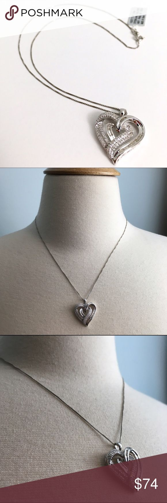Diamond and Sterling Silver Heart Pendant Necklace This double heart necklace is embellished with 1/3 karat, total weight, of diamonds. The chain and the charm are Sterling Silver Jewelry Necklaces
