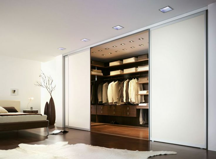 Cream lacquer sliding door has three different track-fixing options for versatility. Ideal with the Space Walk-In Wardrobe by Wackenhut from Campbell Watson.  http://www.campbellwatson.co.uk/superbasket/product/15039/Space+System+Walk-In+Wardrobe+Wackenhut