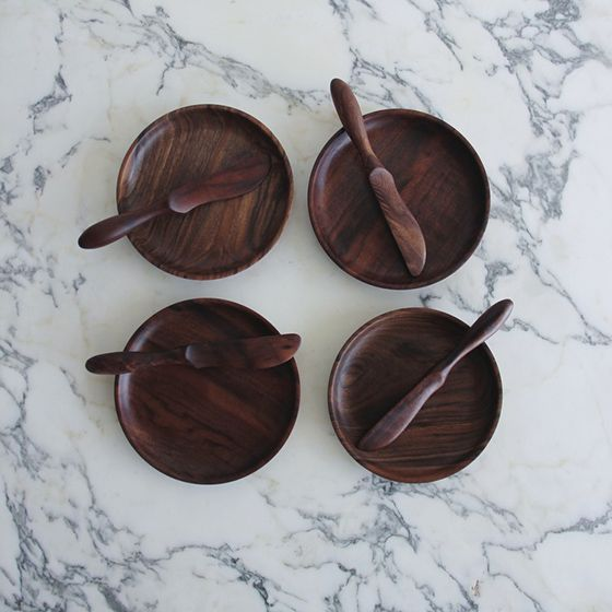 marble counter, wooden plates