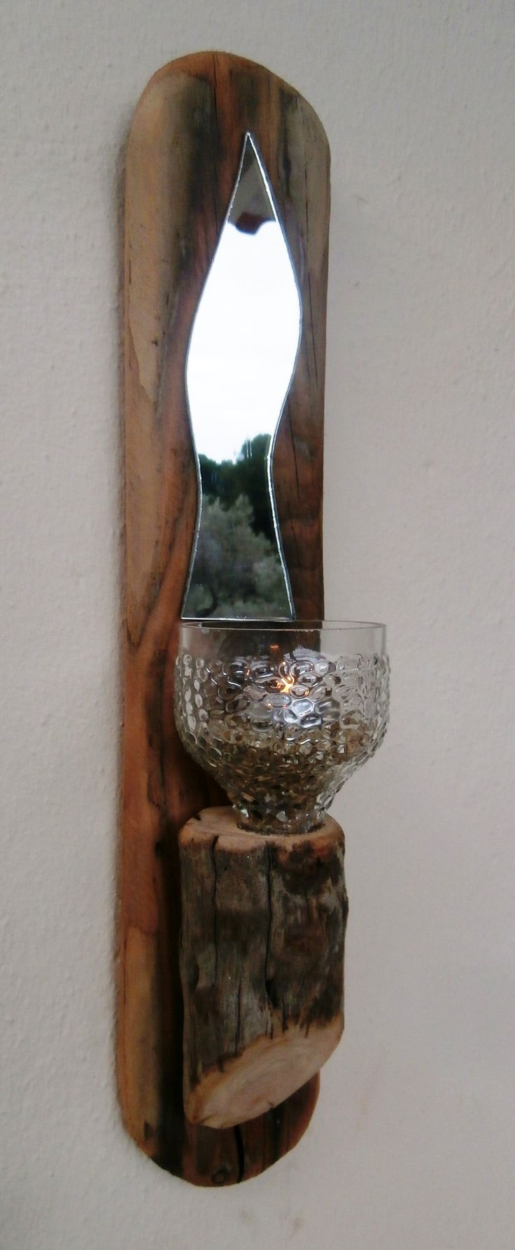Unique driftwood wall hanging tealight sconce, featuring mirror shard and glass tealight holder.